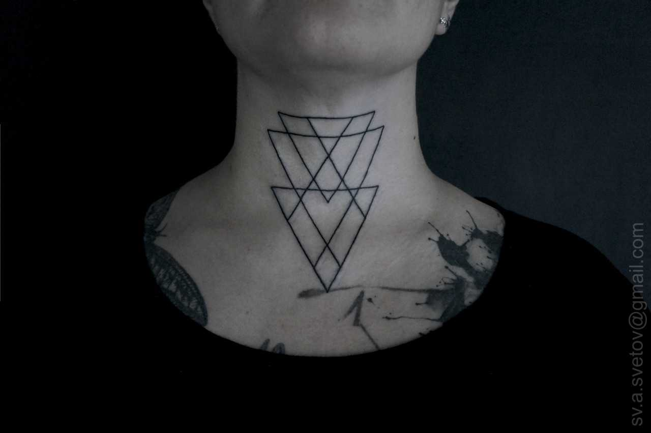 Triple triangle tattoo on the neck