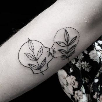 Two heads and branches tattoo
