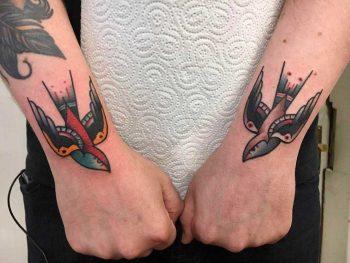 Two swallow tattoos by Jeroen Van Dijk
