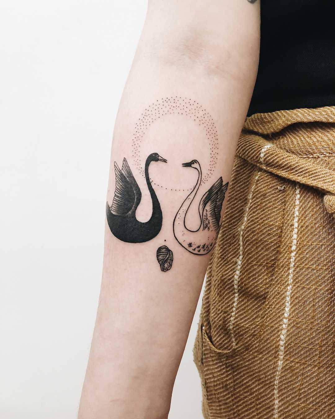 Two swans tattoo