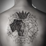 Unfinished geometric lion tattoo