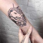 Unicorn tattoo by Slavena Vena