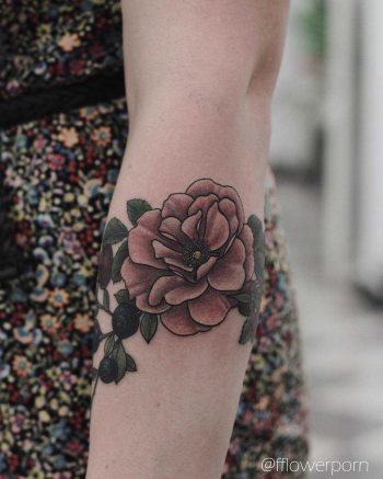 Wild rose and blueberry tattoo