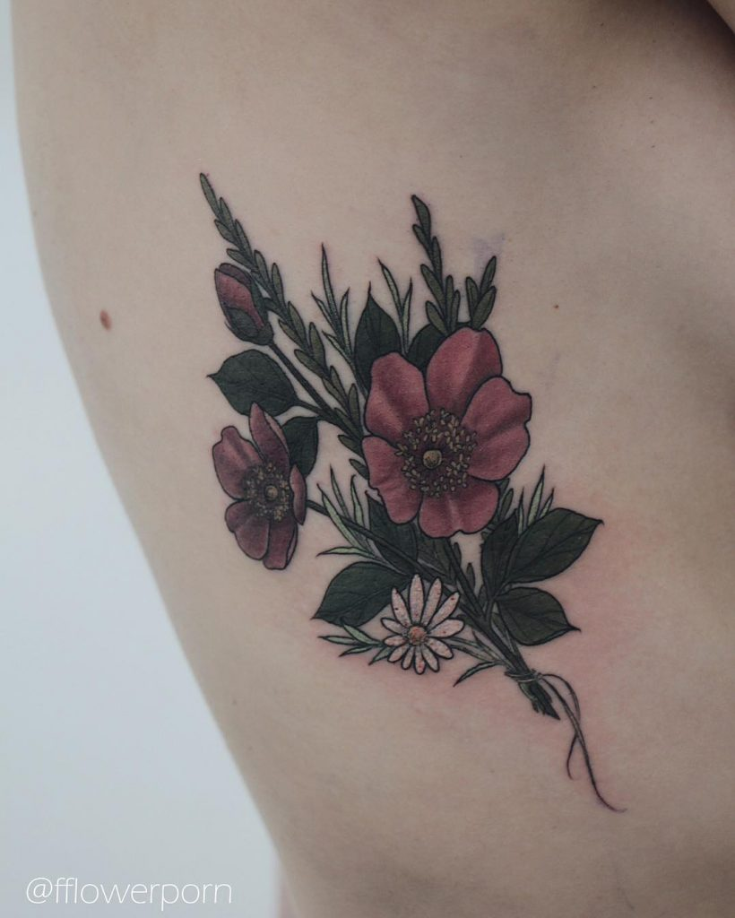 Wild roses tattoo on the rib cage