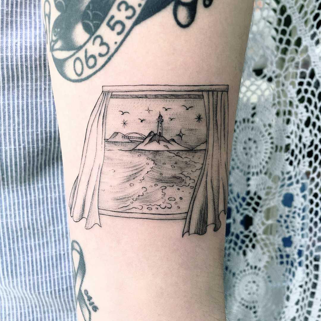 Window landscape tattoo