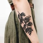 A black branch tattoo by Finley Jordan