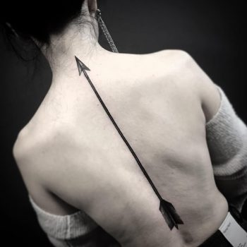 Arrow tattoo on the back by Unkle Gregory