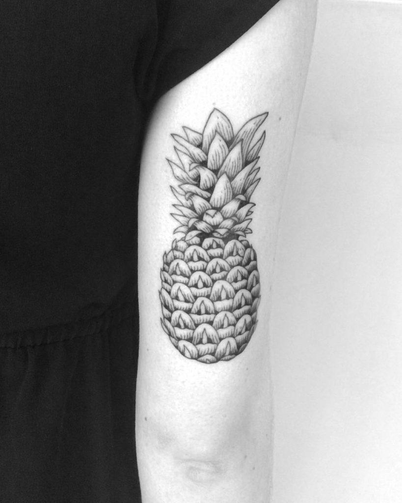 Black and grey pineapple tattoo