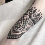 Black ornament tattoo by Jack Peppiette