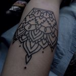 Black outline ornament tattoo