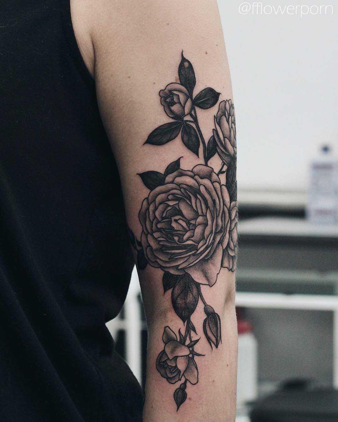 Black rose tattoo by Olga Nekrasova