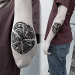 Black tree ring tattoo