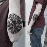 Black tree ring tattoo