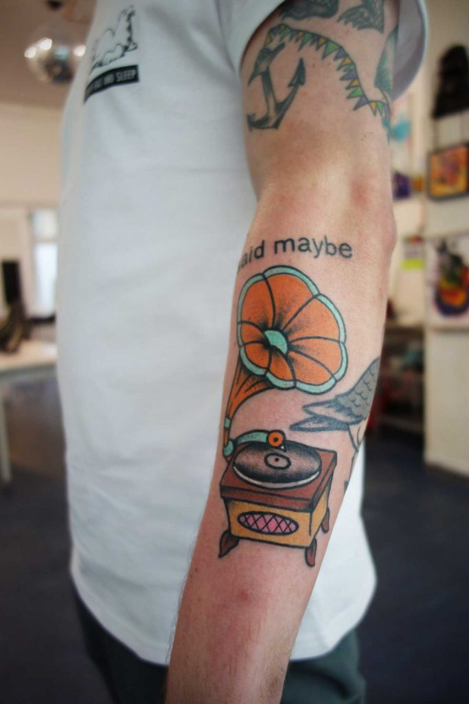 Colorful gramophone tattoo