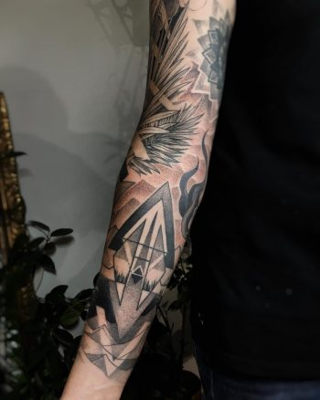 Cool black and grey sleeve tattoo