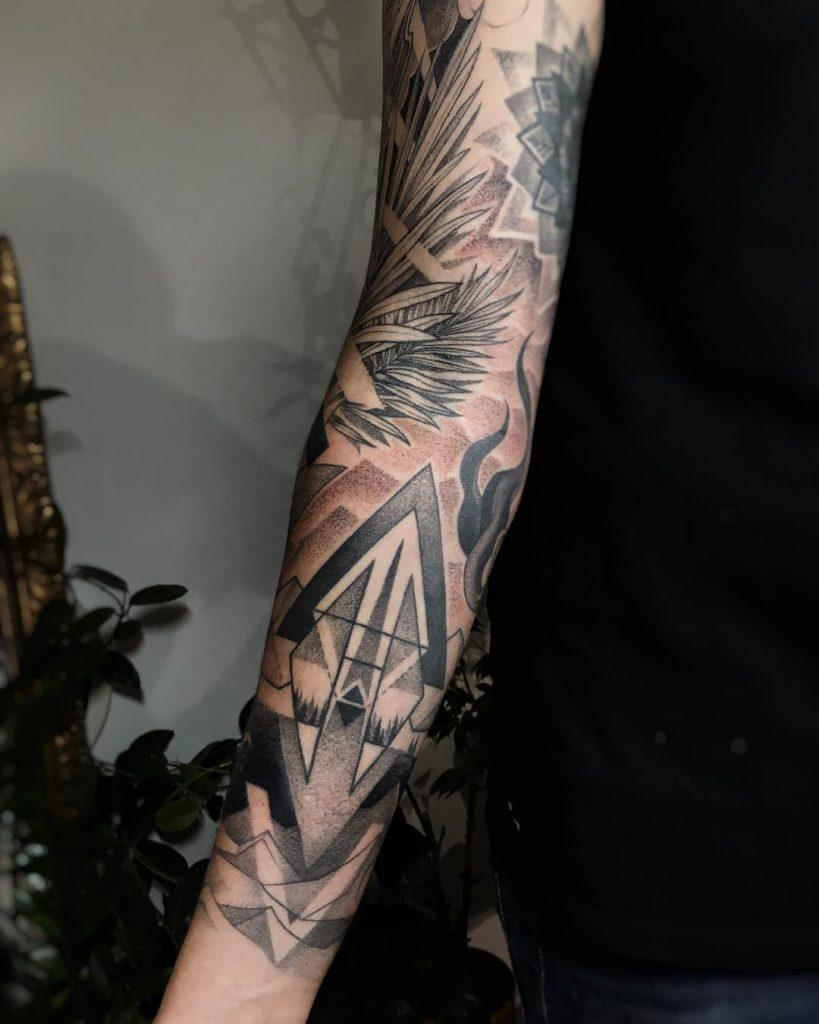 Cool black and grey sleeve tattoo