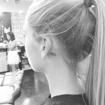 Eye Of Horus tattoo behind the ear