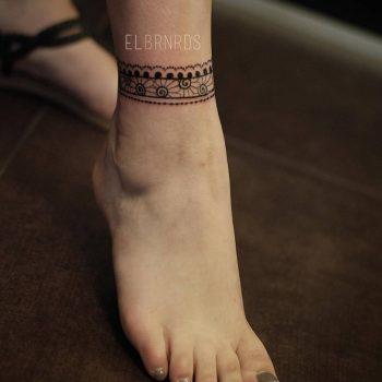 Floral anklet tattoo by Elda Bernardes