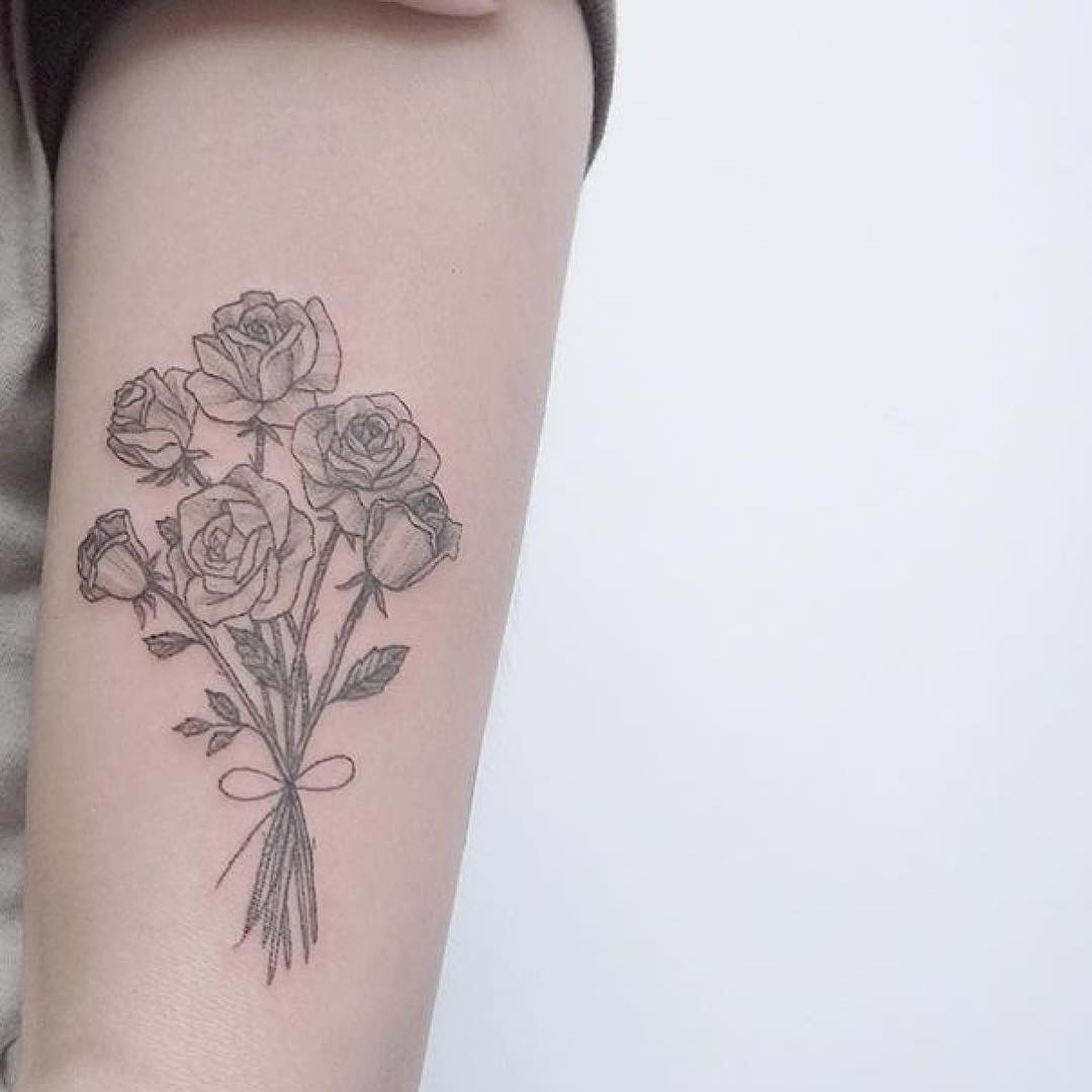 Floral bouquet tattoo by Lindsay April