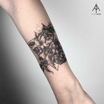 Flower and triangle tattoo by Ilayda Atlas