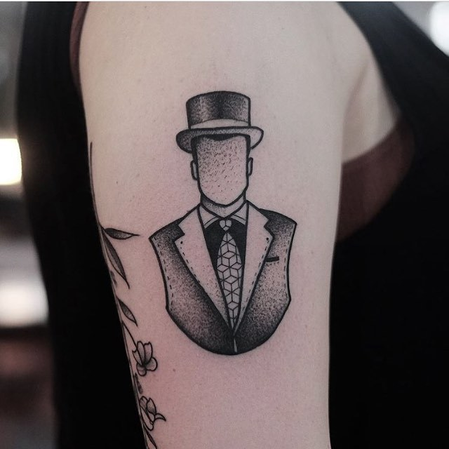 Gentleman's bust tattoo by Jonas Ribeiro