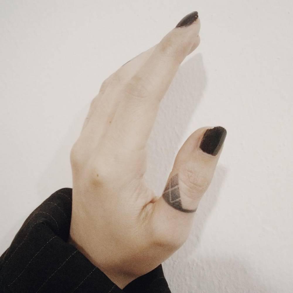 Geometric dot-work ring tattoo