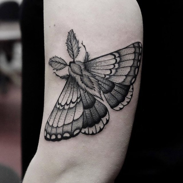 Grey moth tattoo by Roald VD Broek