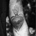 Grey sacred heart tattoo