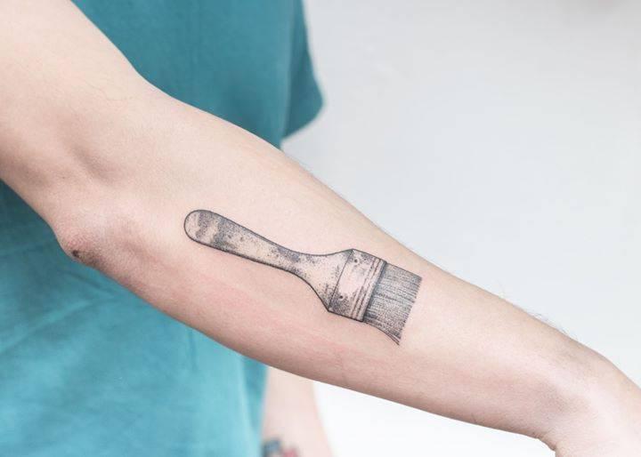 Hand-poked brush tattoo