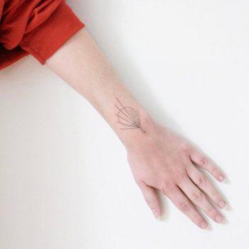 Hand-poked little sunrise and sunset tattoo