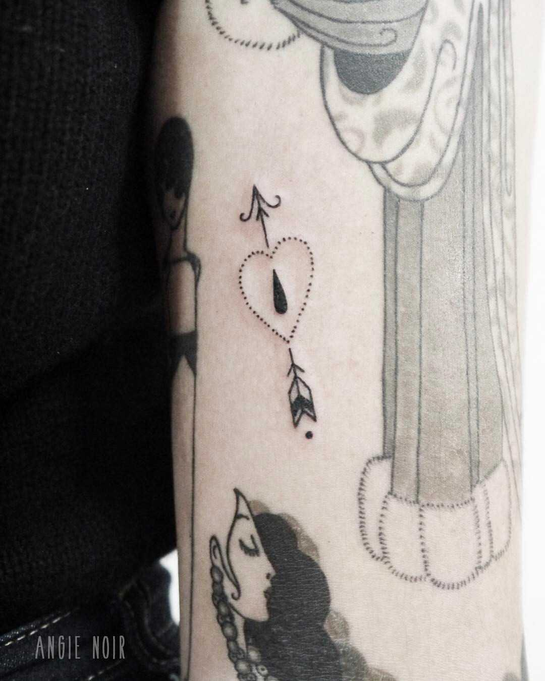 Heart and arrow tattoo by Angie Noir