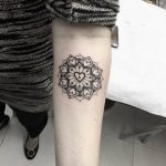 Heart mandala tattoo on the forearm