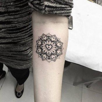 Heart mandala tattoo on the forearm