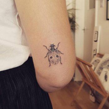Lady Bug tattoo on the arm