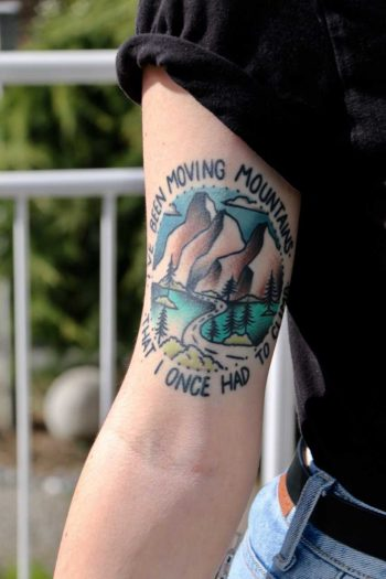 Landscape and quote tattoo