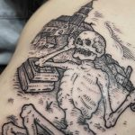 Lazy skeleton tattoo