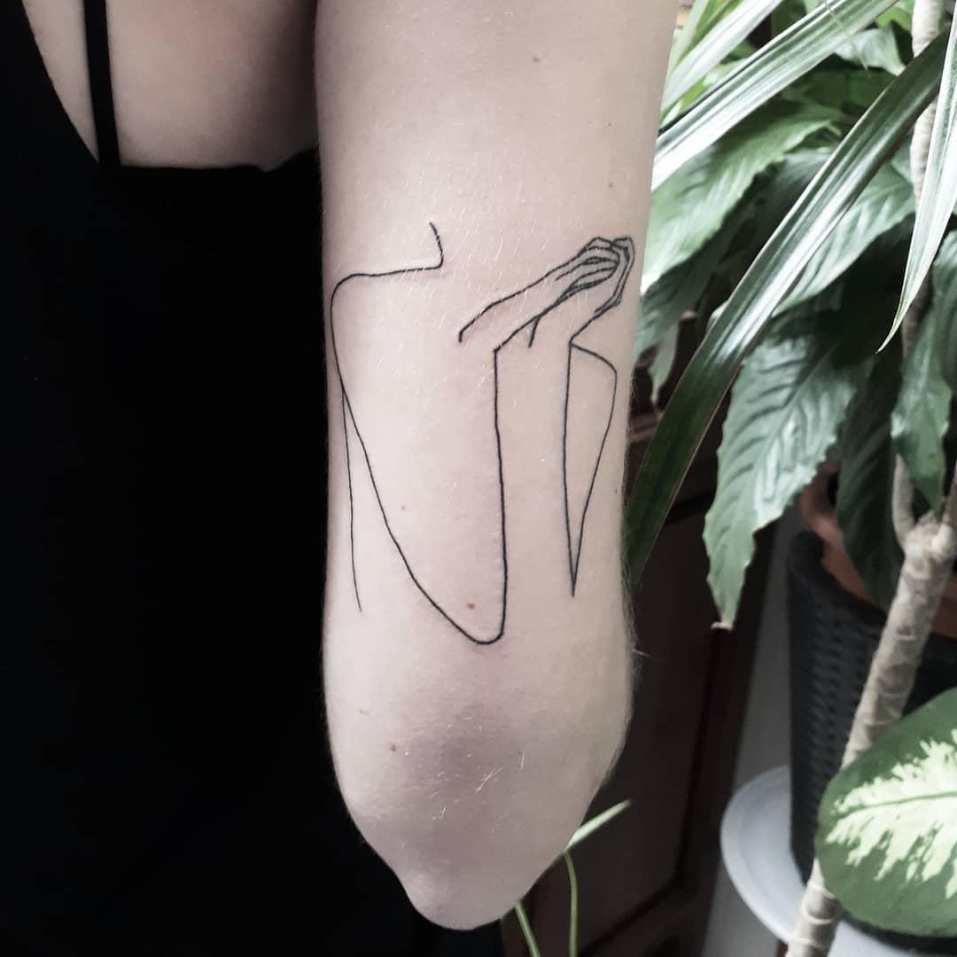 Linear silhouette tattoo