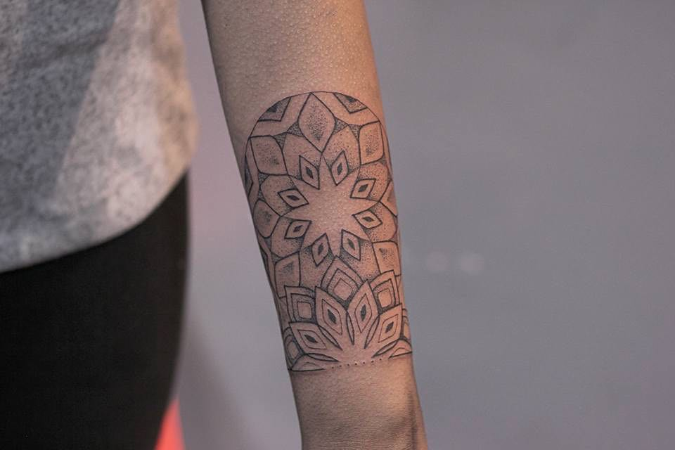 Mandala wrist tattoo by Lindsay April