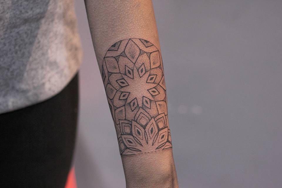 Mandala wrist tattoo by Lindsay April