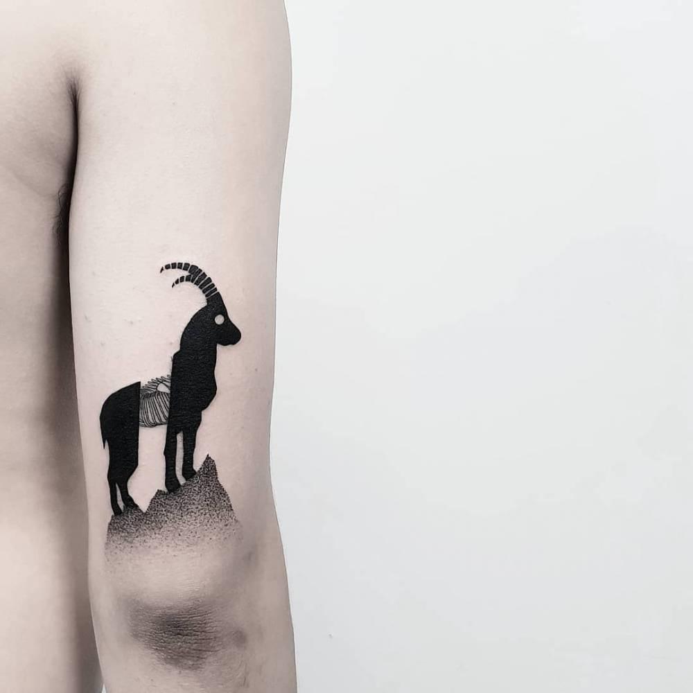 Mountain goat tattoo by Matteo Nangeroni