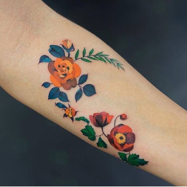 Orange rose and poppy tattoo