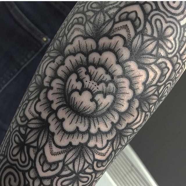 Ornamental flower by Mark Tattooist