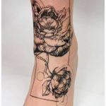 Peony tattoo on the left shin