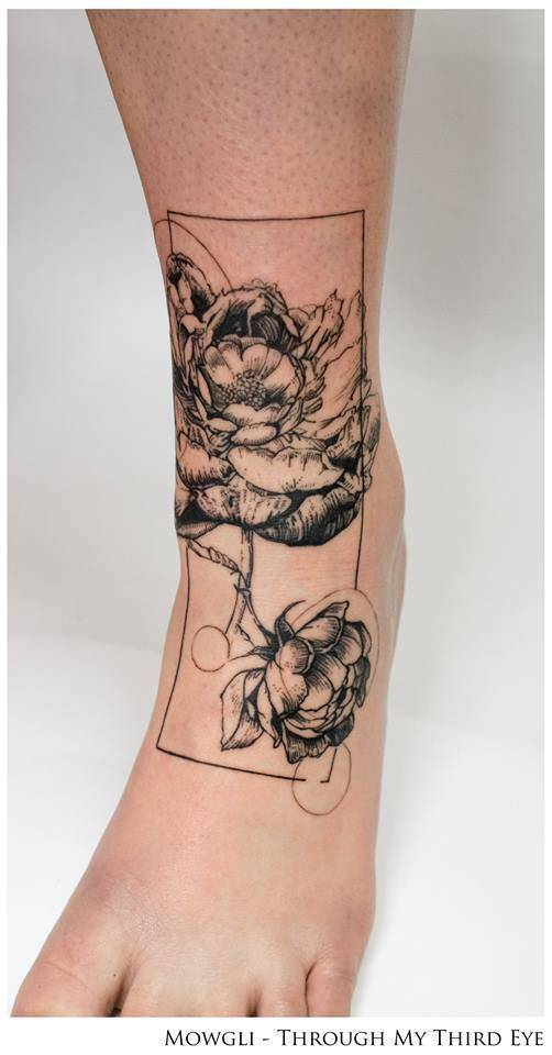 Peony tattoo on the left shin