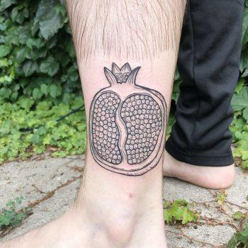 Pomegranate half tattoo