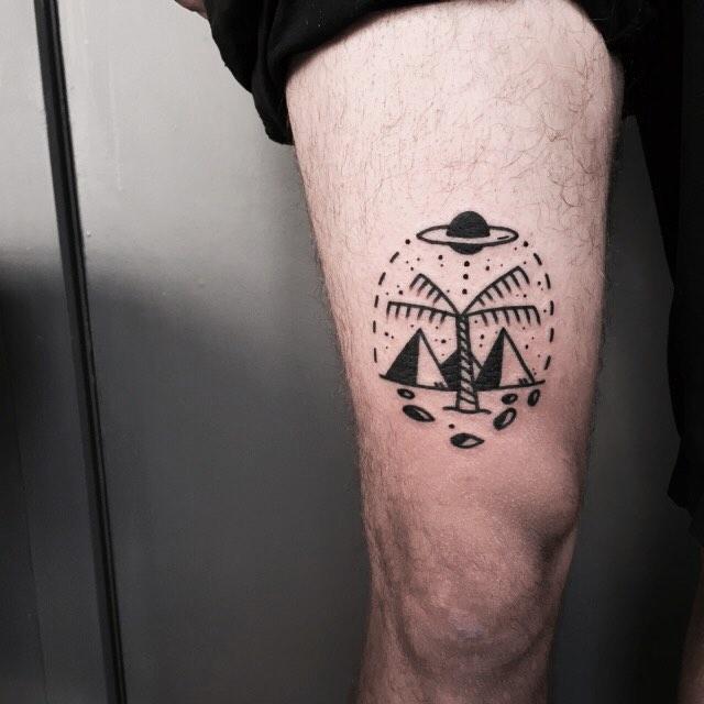 Pyramids and palm tree tattoo