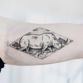 Rhino tattoo by Dogma Noir
