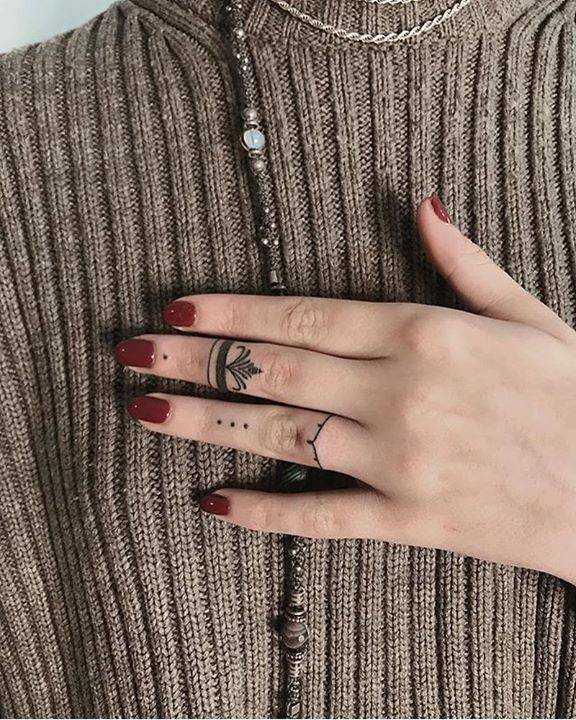 Ring tattoos by Ann Pokes