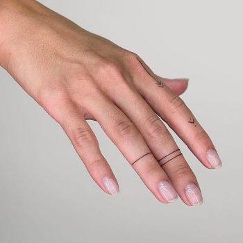 Simple line tattoos on fingers