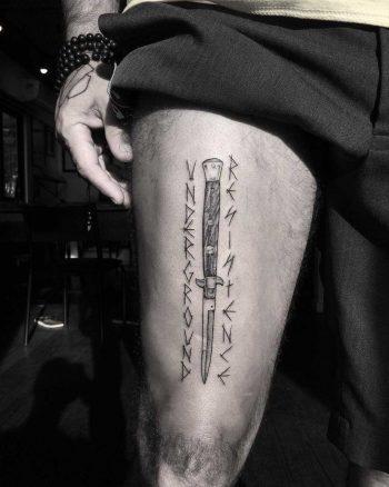 Stiletto and runes tattoo